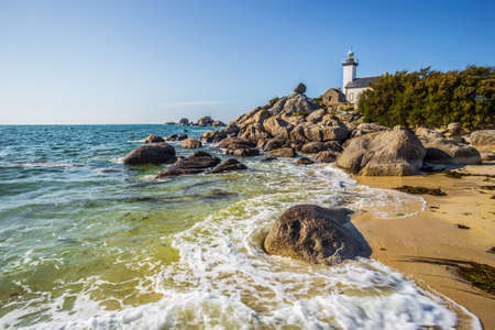 Pontusval lighthouse and the coast in Kerlouan, northern Brittany, France Stock Photo