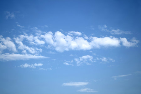 Blue summer sky on a fine day and white cumulus clouds Stock Photo