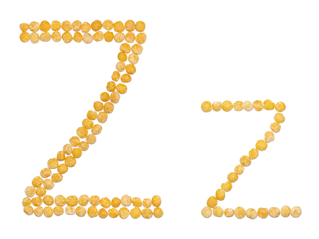 Edible alphabet: uppercase and lowercase letter Z of dry orange peas isolated on white background Stock Photo