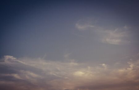 Beautiful dark sky with few clouds on sunset evening Banco de Imagens