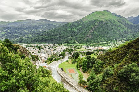 Clean cityscape below the Pyrenees mountains in Spain photo
