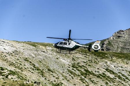 patrolling: Chopper of Guardia civil patrolling over the mountain in Spain