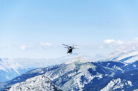 chopper: Chopper  patrolling over the mountain in Spain