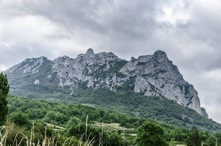 metres: Bugarach is at the foot of Pic de Bugarach, a 1,230 metres Stock Photo