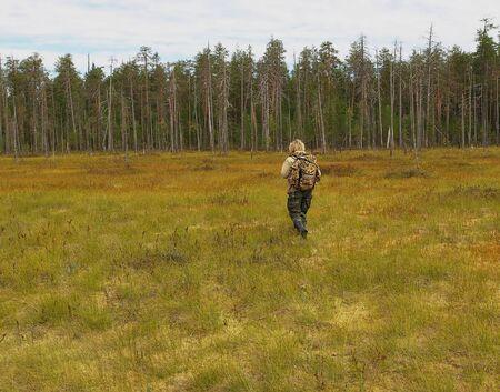 woman crossing the bog