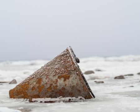 merciless: rusty zinc bucket  become frozen in to ice Stock Photo