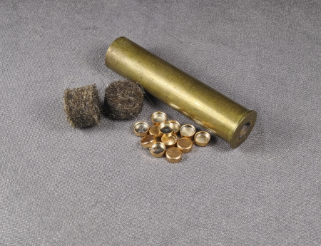 reloading: set of percussion caps and felt wad and brass shell Stock Photo