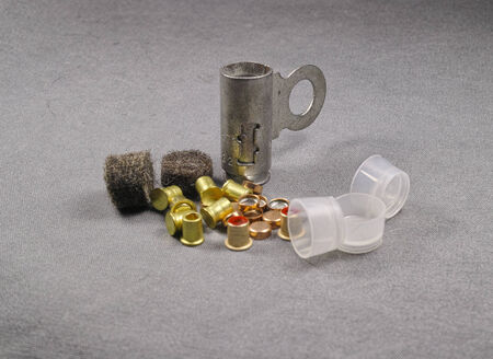 reloading: set of percussion caps and felt wad for reloading Stock Photo