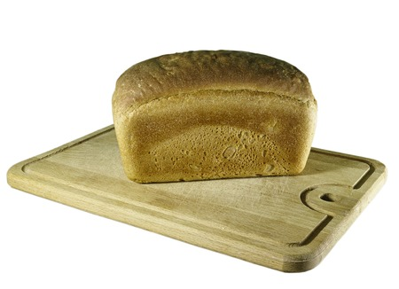 rosy cheeked: rye-bread on cutting board on white
