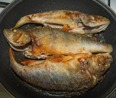 rosy cheeked: roasted perch Stock Photo