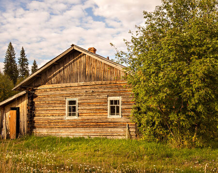 desolate: desolate wooden house at sunset