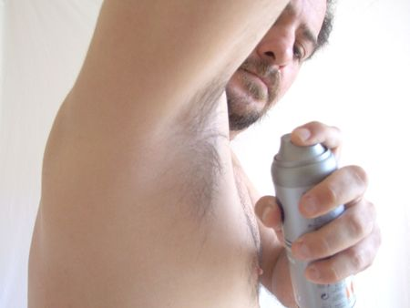 armpits: man spraying deodorant