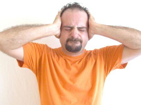 man with a goatee: I dont wanna hear you Stock Photo