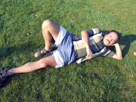 moustached: man chilling on grass Stock Photo