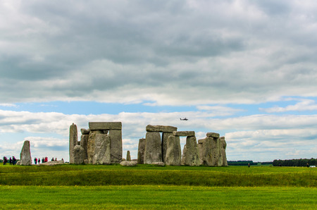 Helicopter flying above Stonehenge on a cloudy day on the Salisbury Plain