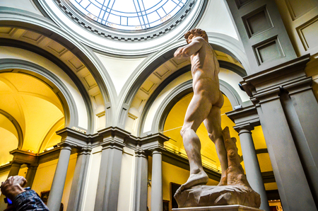 A tourist snaps away at probably the most famous sculpture in the world, The David, by Michelangelo. The marble sculpture by Michelangelo is housed at the Galleria dell'Accademia in Florence