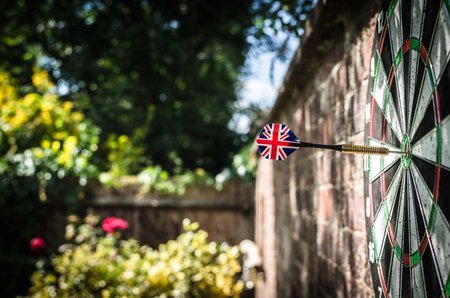 Is Britain standing alone? Brexit? Empire? A single dart on the bullseye to illustrate British themes Stock Photo