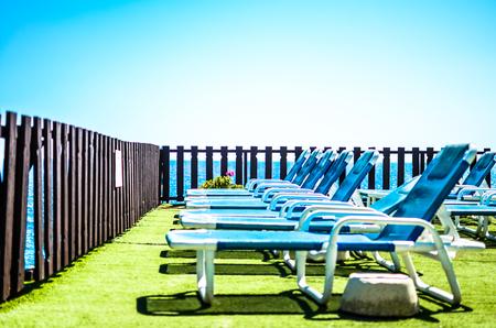 Sun chairs by the sea under a blue sky, Malta