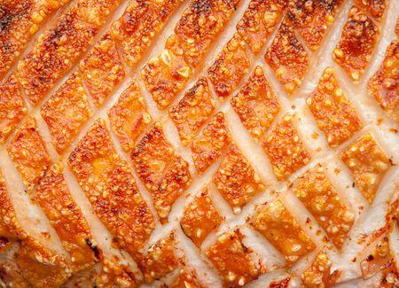 crackling: Pork Crackling on a hogroast Stock Photo
