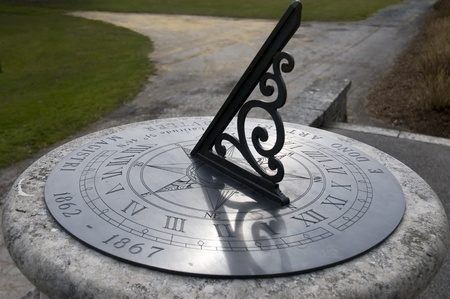 An old sundial showing the time photo