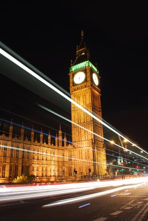 Big Ben with traffic rushing past photo