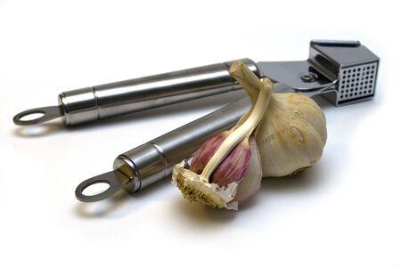 A bulb and a half of garlic and garlic press