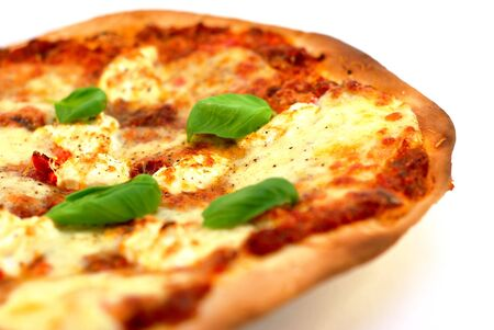 italian cusine: Homemade thin crust pizza on a white background. Narrow depth of field.