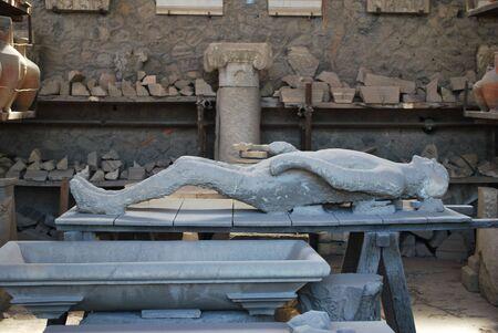 pompeii: Plaster cast of a Pompeii victim in a restoration room. Stock Photo