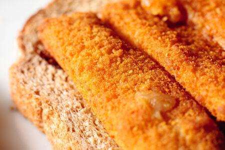 fishfinger: An open fish finger sandwich on a slice of wholemeal bread