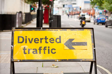 diverted: A yellow traffic diversion road sign with an arrow pointing left