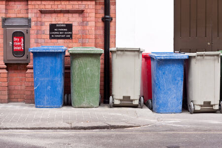 A row of different coloured wheelie bins Stock Photo