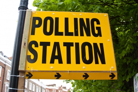 polling: A yellow and black polling station sign, UK