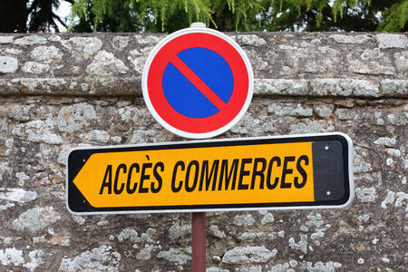 french way: A French roadsign pointing the way to shops