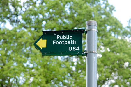 A green UK public footpath directional sign Stock Photo