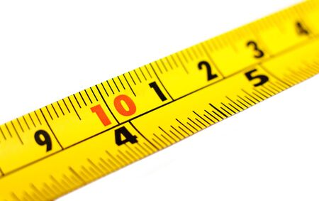 millimetres: Close-up of a yellow tape measure isolated on a white background Stock Photo