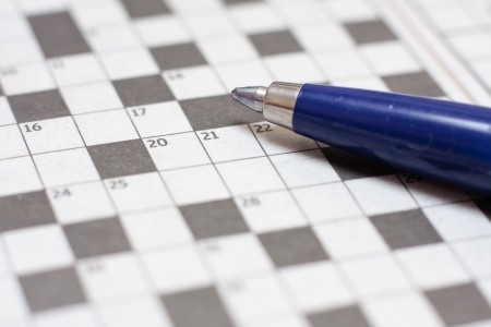 clues: A close-up image of a ballpoint pen on a blank crossword