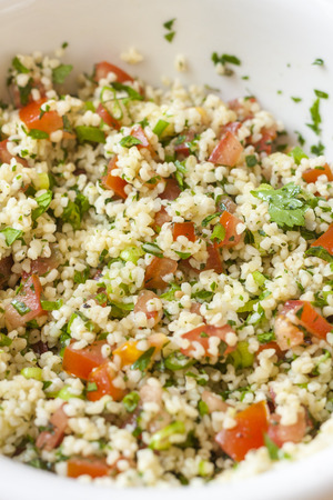 tabbouleh: Fresh tabbouleh, a Middle Eastern salad, in a white bowl