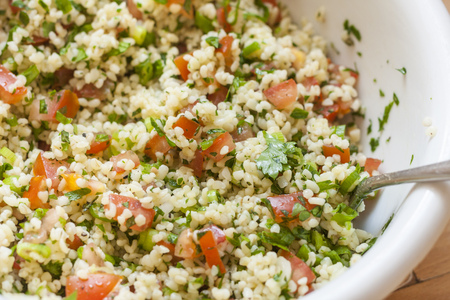 middle eastern: Fresh tabbouleh, a Middle Eastern salad, in a white bowl