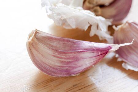 garlic clove: Close-up of a garlic clove on a wooden background Stock Photo