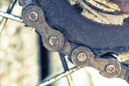 greasy: Close-up of a greasy bicycle chain and sprocket