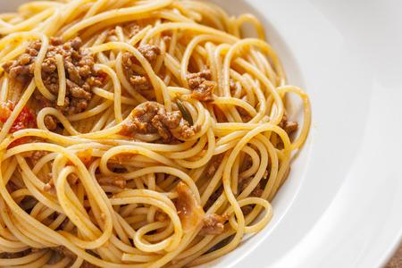 spaghetti bolognese: Spaghetti Bolognese in a white bowl
