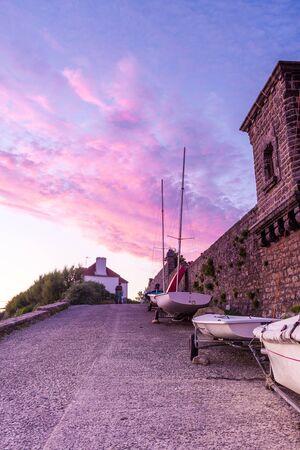 plage: Boats at Plage de Kervillen, Brittany, France, during a warm sunset