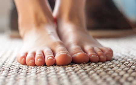 bare feet boys: Close-up of a pair of young boys feet Stock Photo