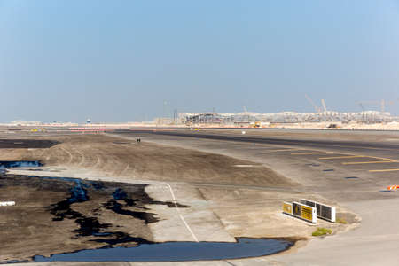 Abu Dhabi Airport under construction on a hot summers day.