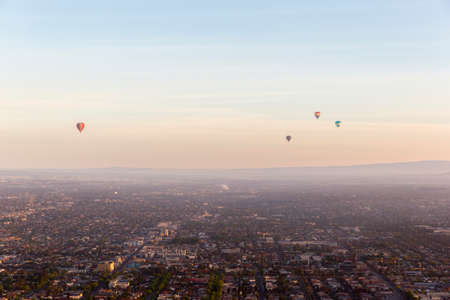 Hot air balloons floating gracefully above Melbourne northern suburbs on a perfect winters morning. Stock fotó