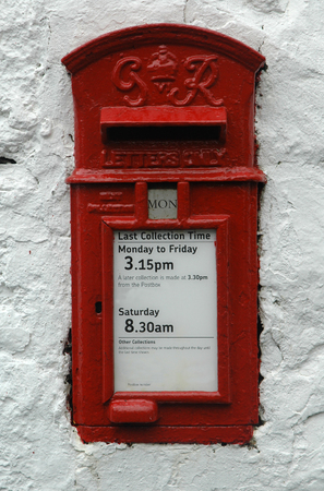 royal mail: An old British Royal Mail Postbox set in a white stone wall