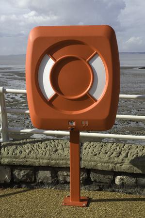salvavidas: A red lifesaving belt on the sea front