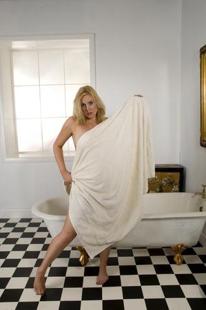 bathtowel: A blonde woman wearing a bathtowel