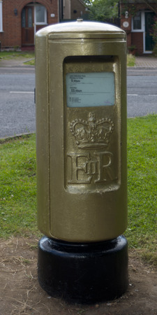 keirin: STOTFOLD, BEDFORDSHIRE, UK - AUGUST 8:  Golden Postbox to commemorate Victoria Pendletons Keirin Cycling Gold Medal at London 2012 Olympics on 3 August 2012