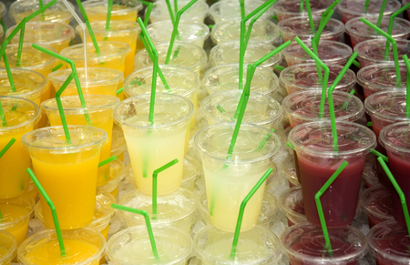 A selection of freshly made fruit juices on a market stall Stock Photo
